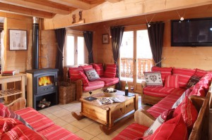 Living room with fire in the Chalet Louisa, Alpe d'Huez, France