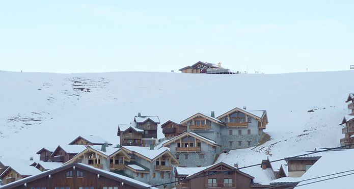 Mountain Flower Chalets (centre) with the piste above and coming down the left