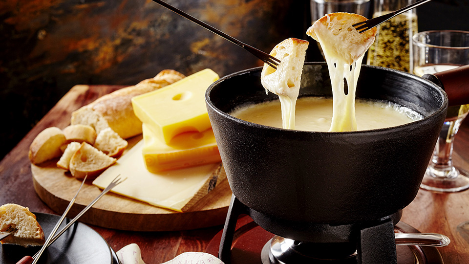 Typical fondue in a restaurant - shutterstock_484573408