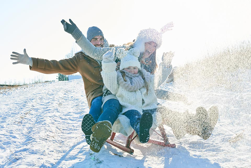Family toboggan in the winter