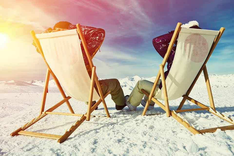Two skiers in deck chairs