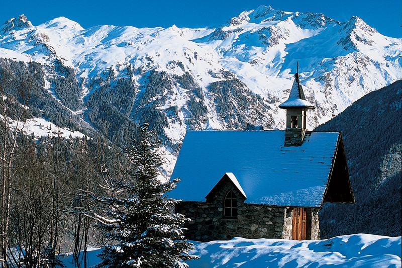 Church in Courchevel, France with the ski resort in the background