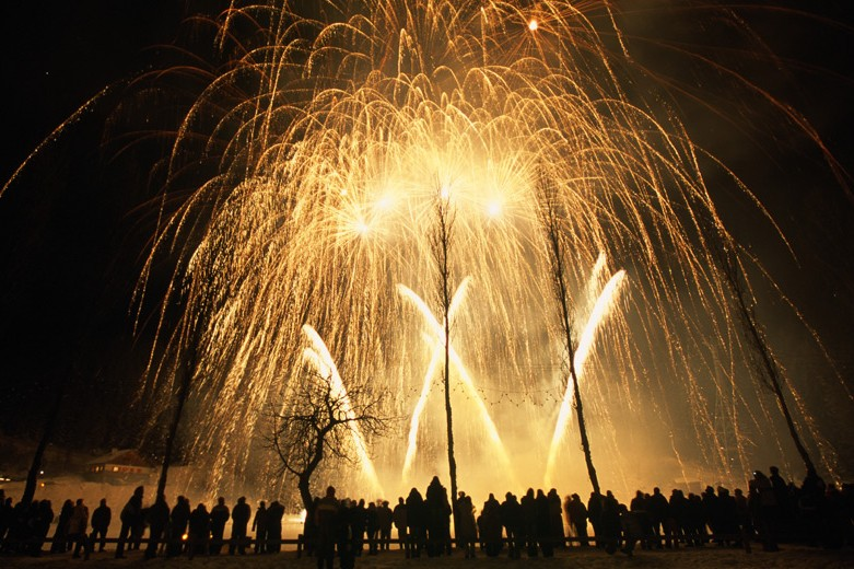 Crowd watches fireworks at night in Courchevel, France
