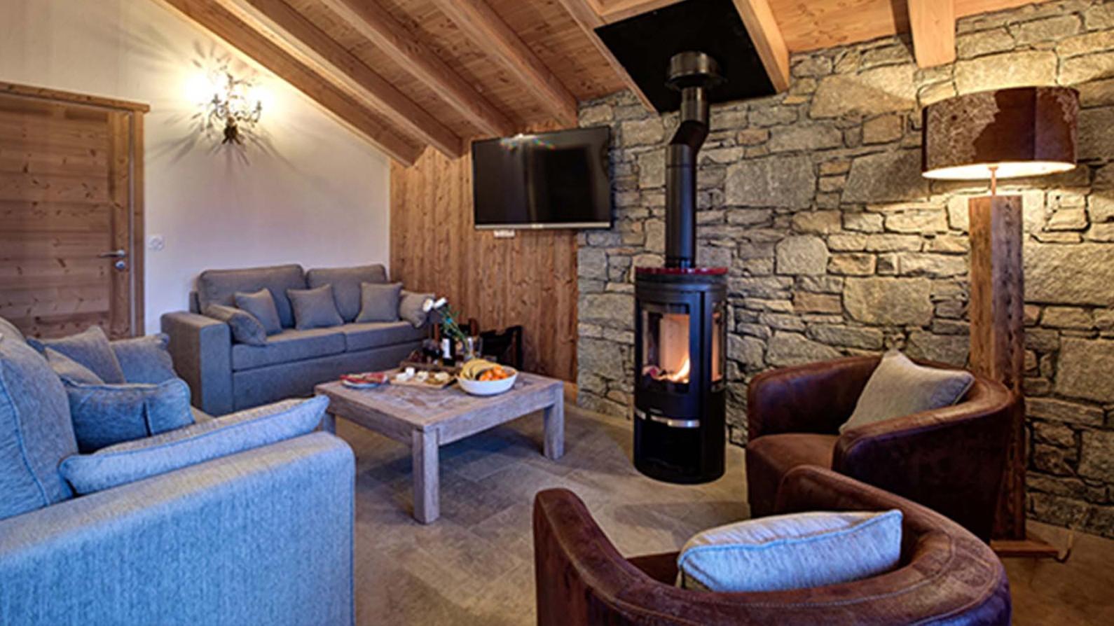 Lounge area with fireplace, Chalet Crocus Blanc, La Plagne, France