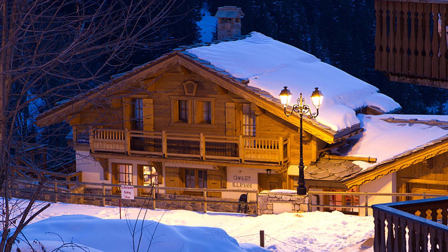 Chalet Estrella exterior at night, Courchevel