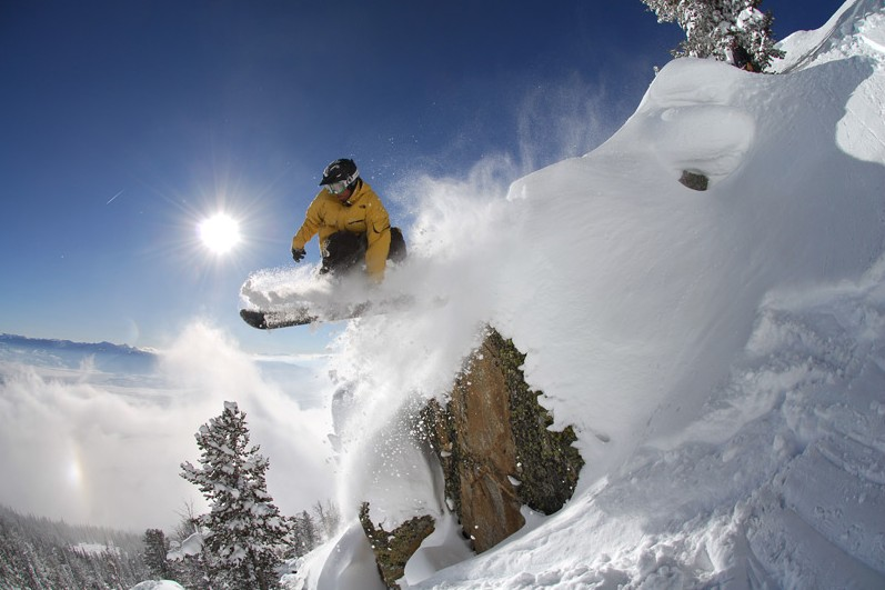 A snowboarder enjoying perfect powder snow in Jackson Hole