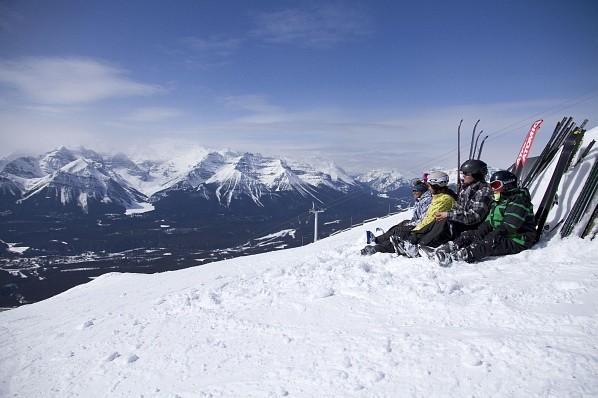 Skiers taking a break in Lake Lousie