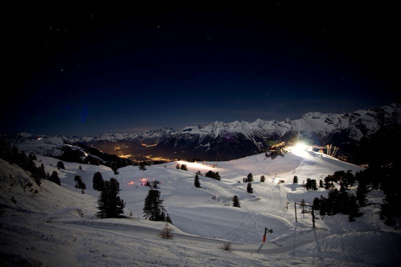 Ski area and town at night, Nendaz, Switzerland