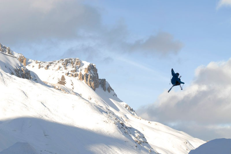 Huge air under a clouded sky in Tignes
