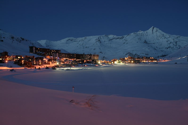 Tignes village lit up at night