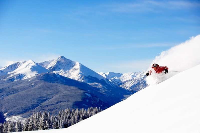 Deep powder skiing duringa  ski holiday in Vail