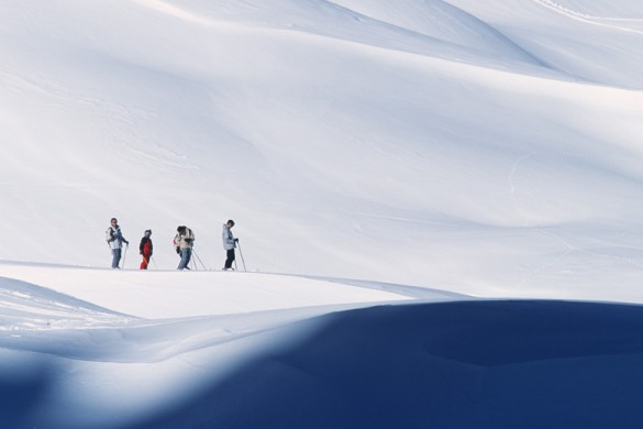 Skiers fresh snow in Courchevel skiing, France