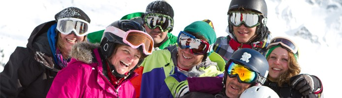 group ski holiday deals - group skiing on the slopes