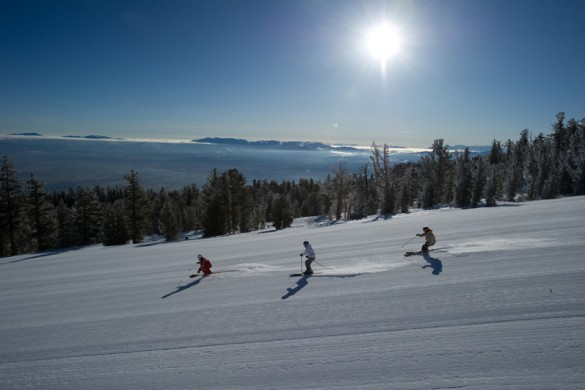 A trio of skiers enjoying sunlit pistes in Heavenly