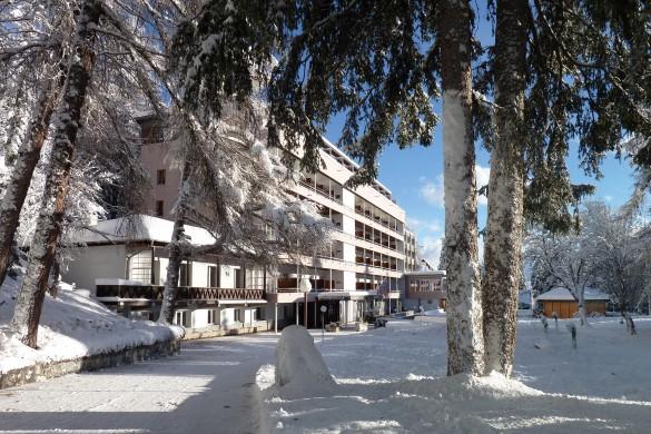 Hotel Valaisia-Snowy Exterior-Ski Hotel in Crans Montana, Switzerland