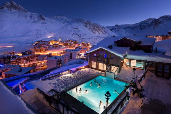 Outside swimming pool night time in the Village Montana - Self-catered ski apartment in Tignes, France