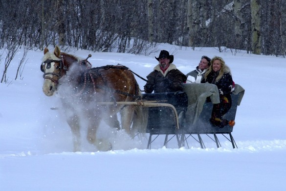 A couple enjoy a sleigh ride in the snow in Steamboat