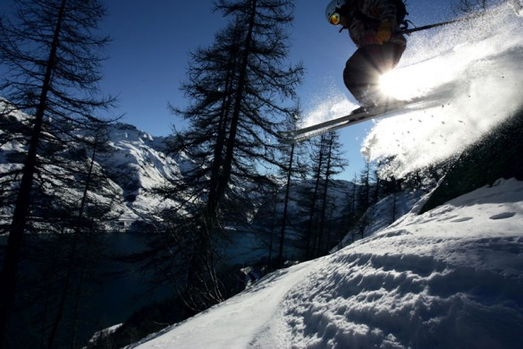 A skier leaping through the trees in Tignes