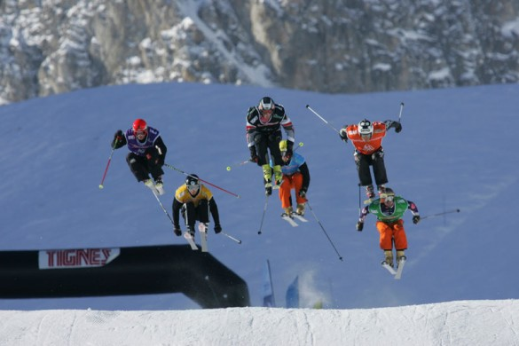 Skiers competing on the skier cross course in Tignes
