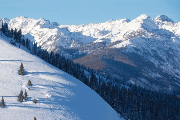 A solo skier tackles fresh snow in Vail
