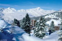 View into La Plagne town from behind the snow covered trees