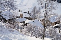 Fresh snow on the ski chalet rooftops in Meribel