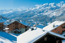 Snow covered rooftops of catered chalets in Meribel, France