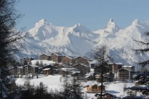 Nendaz, Switzerland, shadowed by peaks