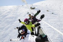 A family having fun on the chair lifts in Val Thorens