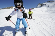 Children skiing on a family ski holiday in Val Thorens